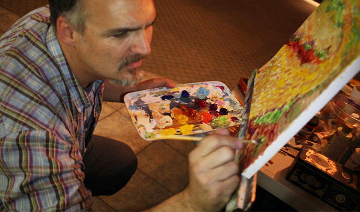 Dominic Martinelli painting during worship at The Bridge in Carson City